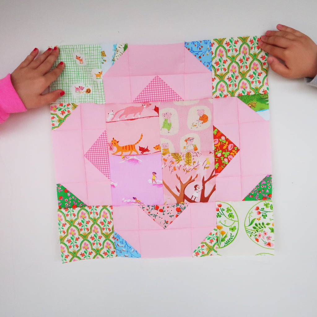 Suncatcher Stars Quilt, made by Laura of Sweet Cinnamon Roses and design by Lou Orth