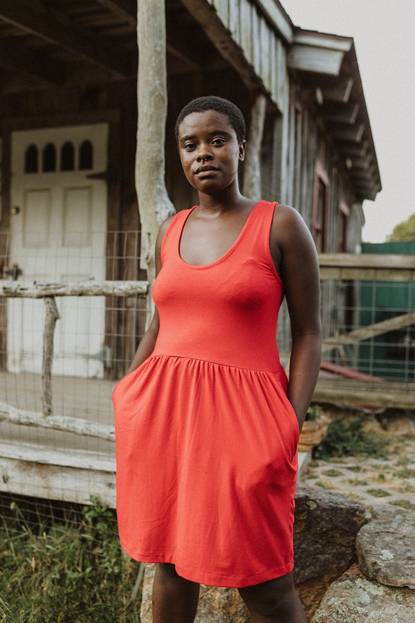 A fit-and-flare style dress made of jersey cotton. The top is a tank-style with a scoop neck. Sustainably made by Conrado using deadstock fabrics, shop it at Hyperbole in the Hudson Valley inNew York,
