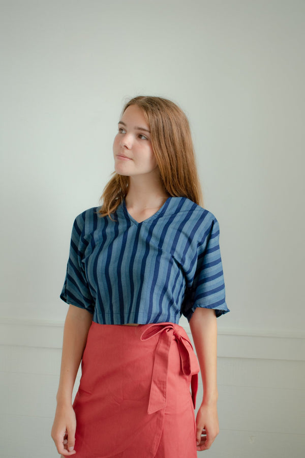 A sweet and easy wrap mini skirt, with a tie closure on side for charming bow. Back waist is finished with an elastic for extra comfort. Made by Conrado, available Hyperbole in New York