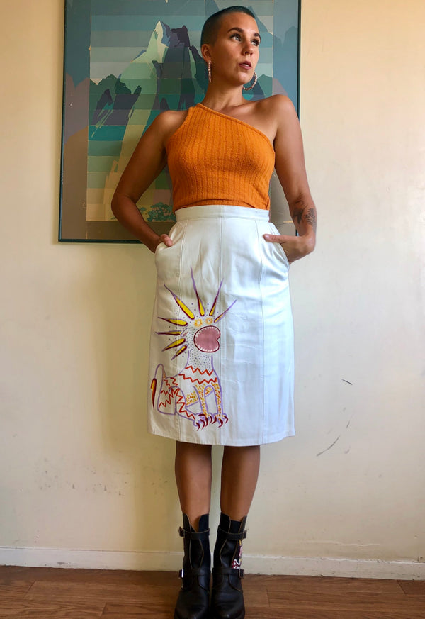Vintage white leather skirt, hand painted with bright colors, available to shop at Hyperbole in New York's Hudson Valley