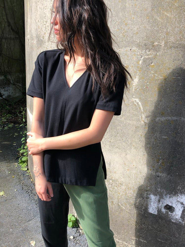 The Humboldt V Neck Shirt is a classic style, that's few steps above your average tee. Thoughtfully designed with side slits, a high low hem, and a drop shoulder. Sustainably made organic cotton by Chan + Krys. Made in NYC