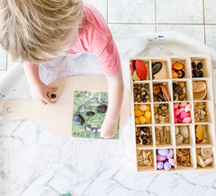 Child playing with loose parts