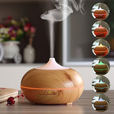 Wooden Aromatherapy Essential Oil Diffuser shooting mist into the air.