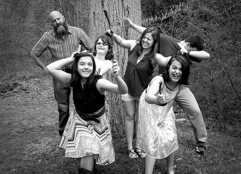 Six people acting silly in black and white.