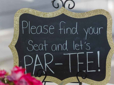 """""""Please Find Your Seat and Let's PAR-TEE"""" chalk sign."""