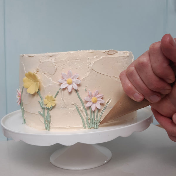 Piping leaves wildflower cake