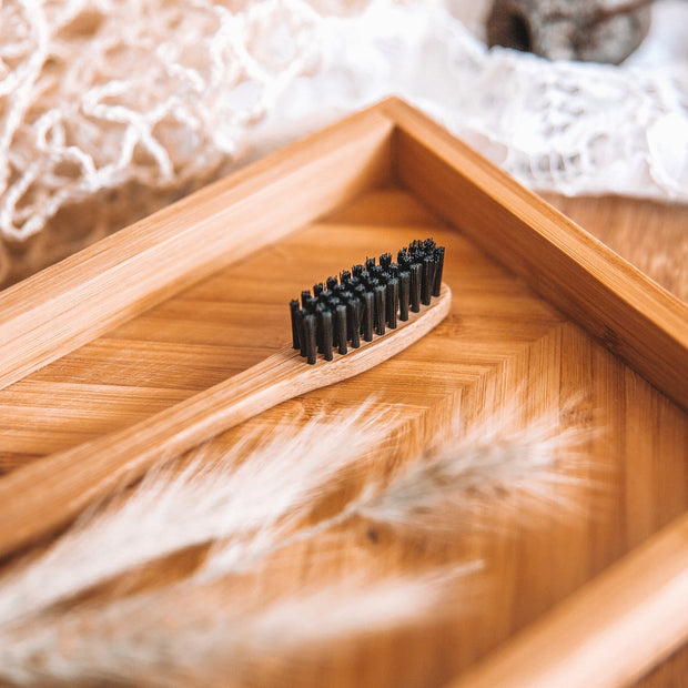 Biodegradable eco-friendly Bamboo Toothbrush with charcoal bristles