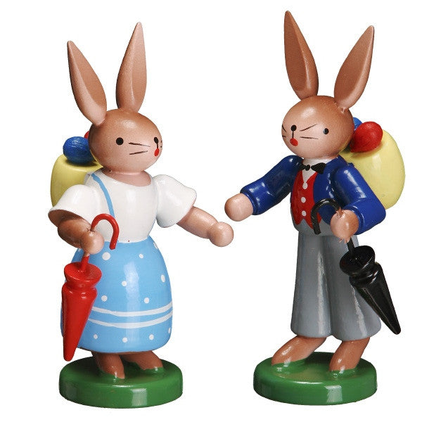 Bunny Couple with Easter Eggs and Umbrellas