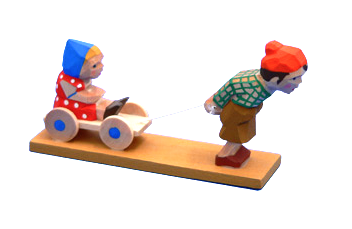 Young Boy pulling a Little Girl on a Wagon
