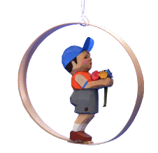 Boy with Flowers in Shaved-Wood Ring Ornament