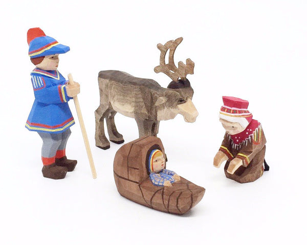 Lapp Couple with Child and Reindeer