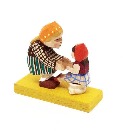 Mother with Child Sitting on Pot