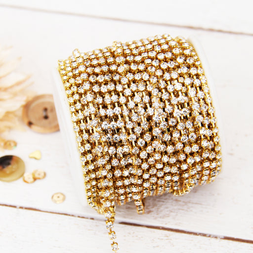 Rhinestone Chain SS10 - 10 yd Roll - Crystal/Gold - Threadart.com