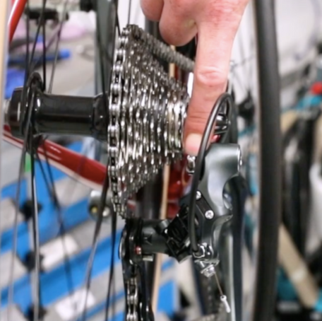 How to adjust a rear derailluer