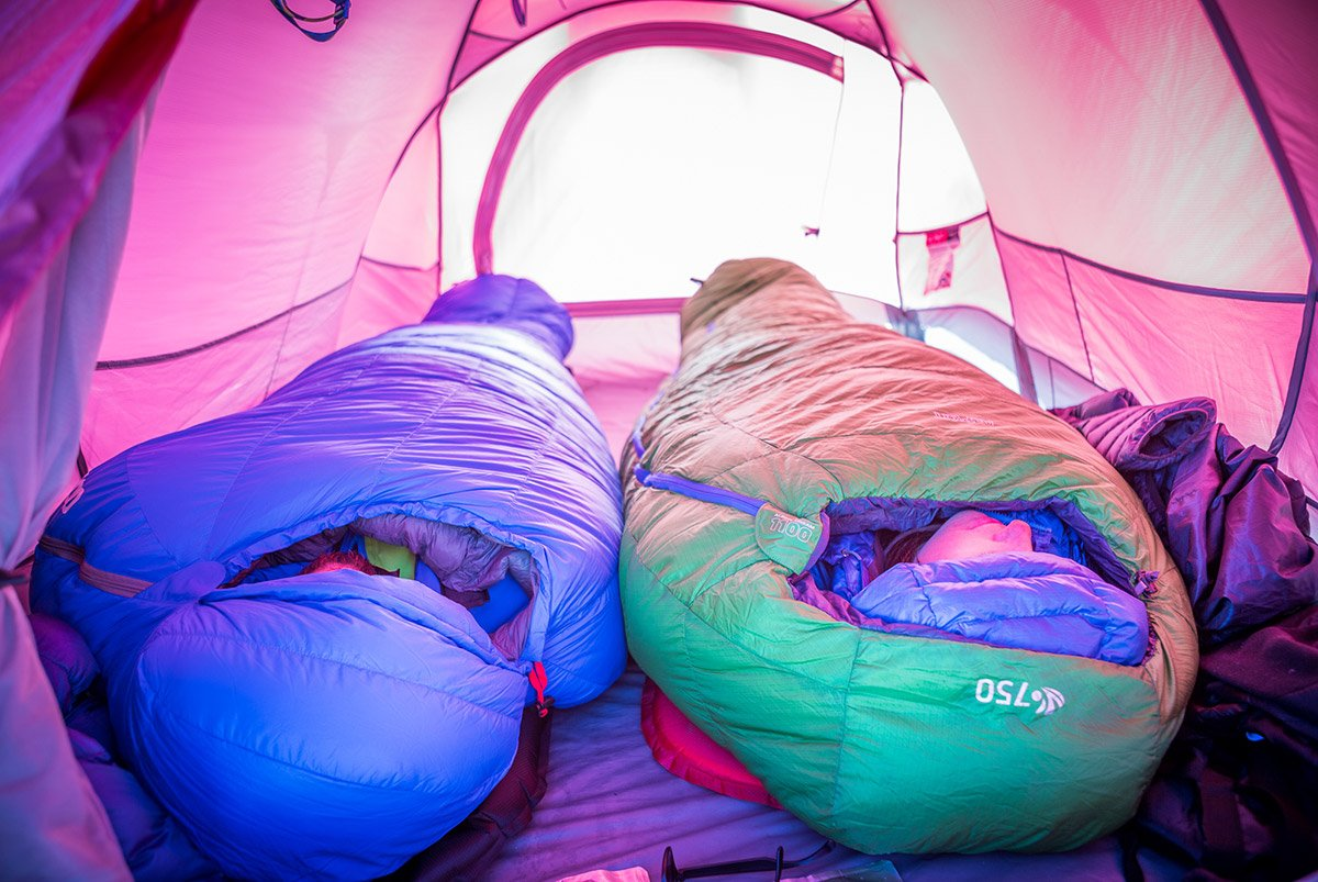 Two people sleeping in expedition sleeping bags while winter camping