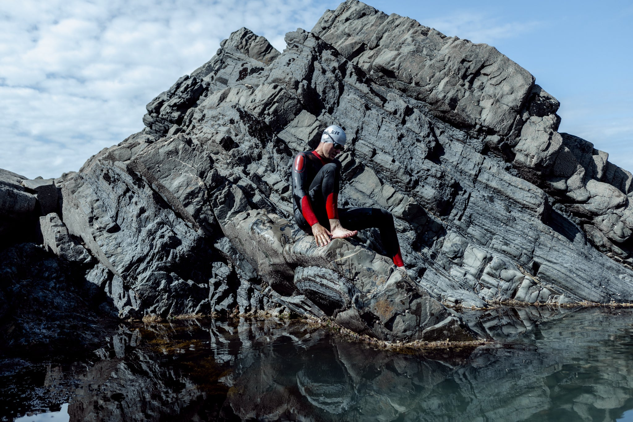 getting into the water in a wild swimming wetsuit