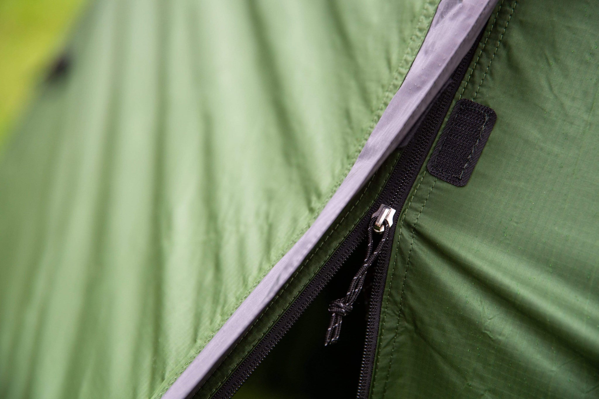 Close-up of a tent zip on the outer tent