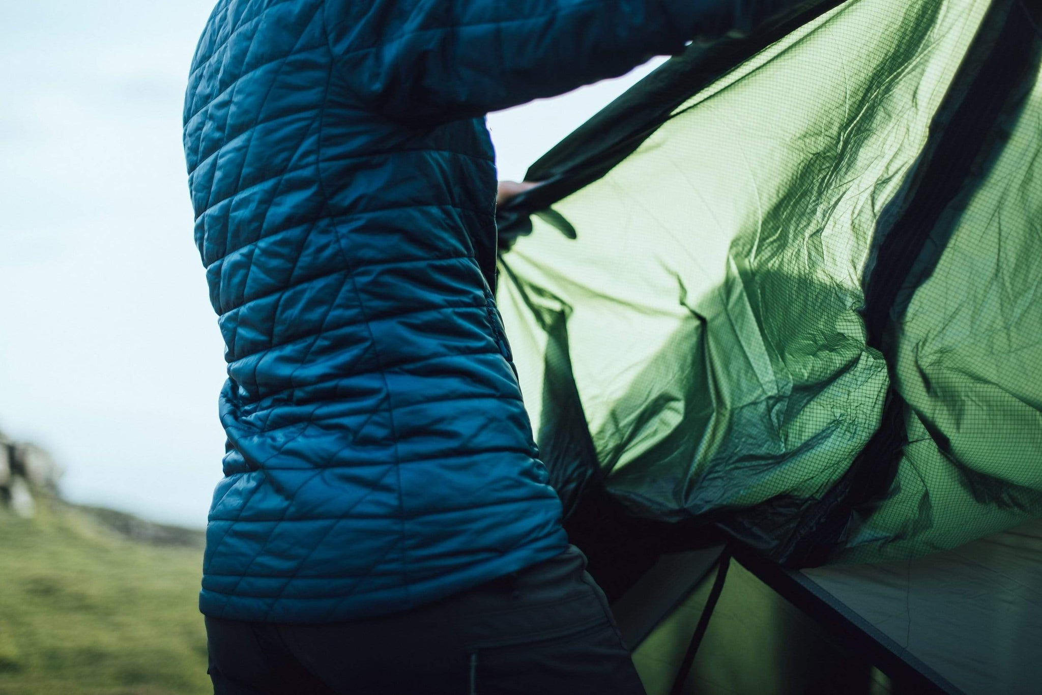 Pitching a tent and putting the fly sheet on top