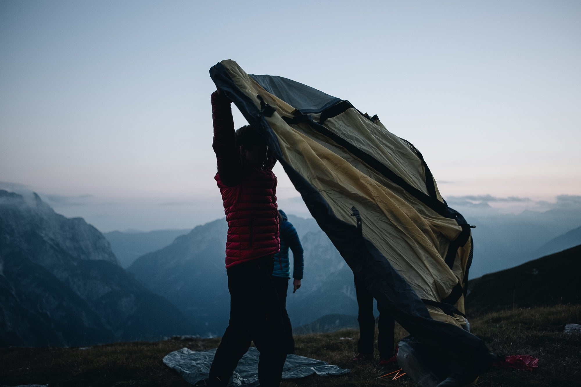 Two people putting up a 4 season mountain tent in the Slovenian mountains