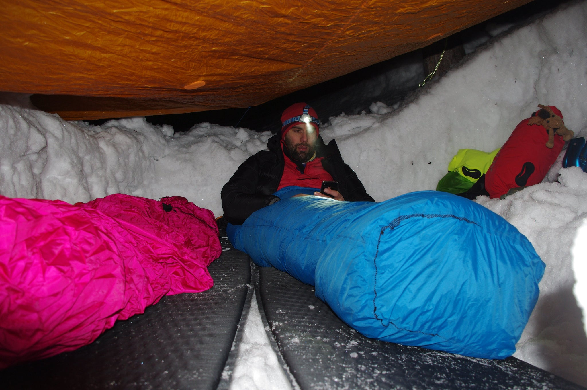 Winter camping and sleeping inside a snow hole