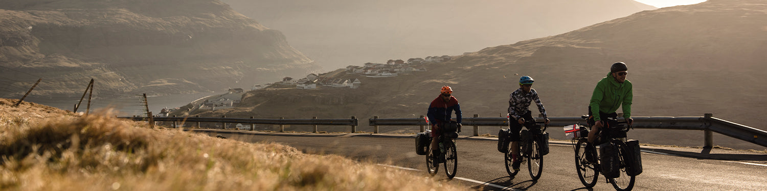 3 friends cycle touring in the Faroe Islands with pannier bags
