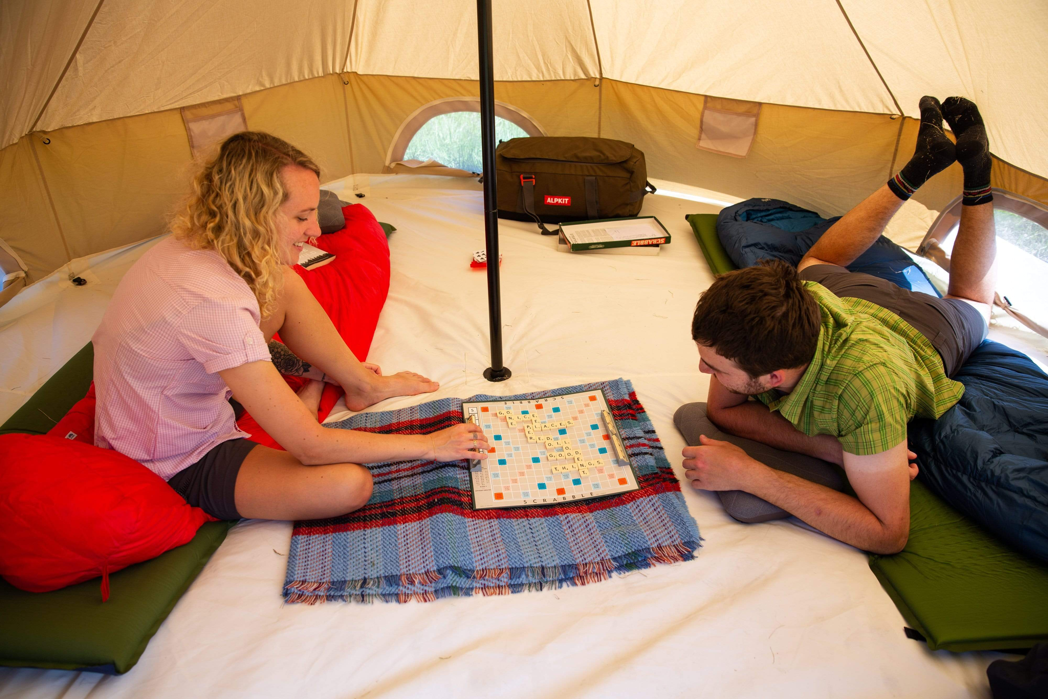 Playing Scrabble and board games inside the Roundhouse organic cotton bell tent