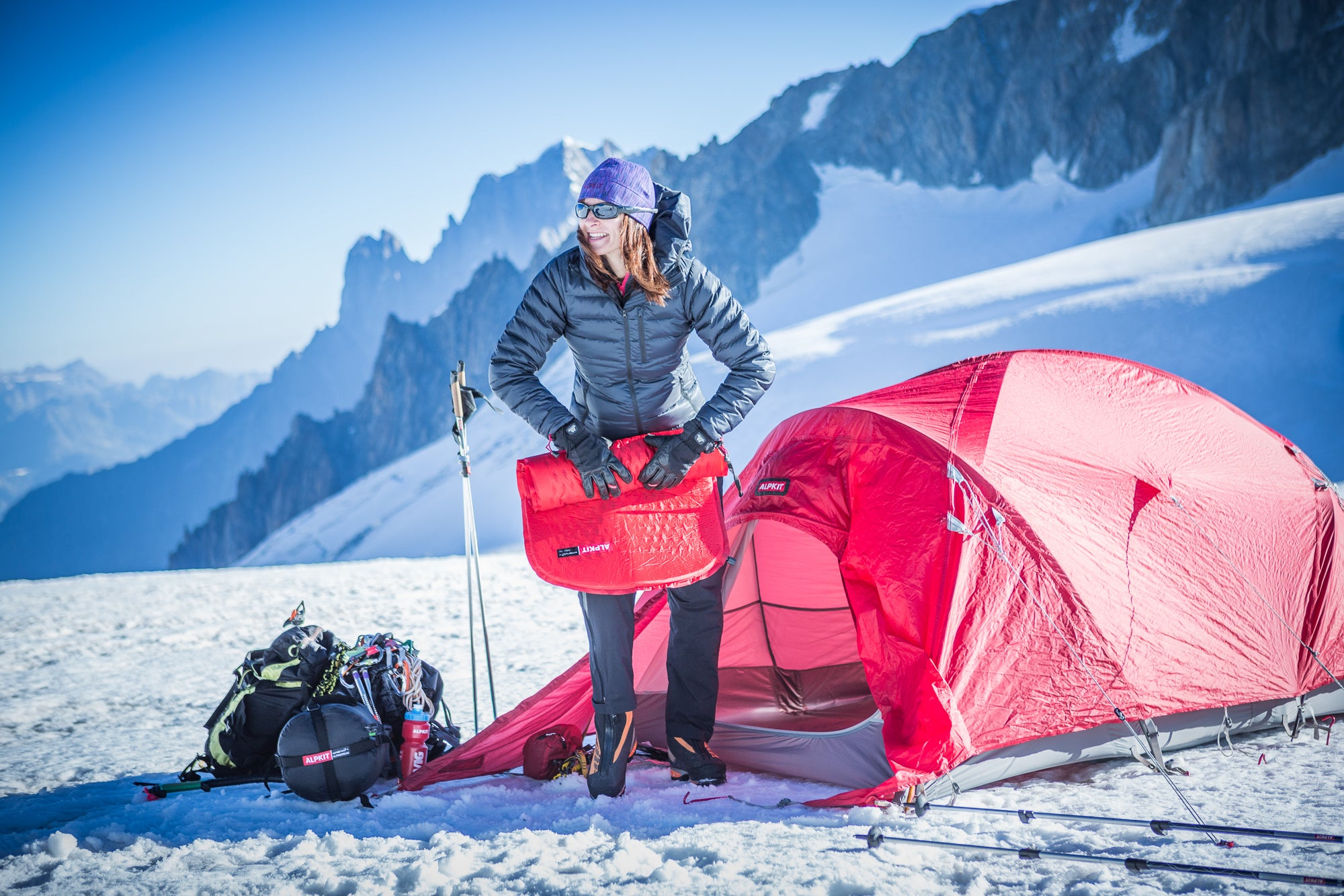 Rolling up an Airo 180 sleeping mat, camping on the snow in the mountains near Chamonix