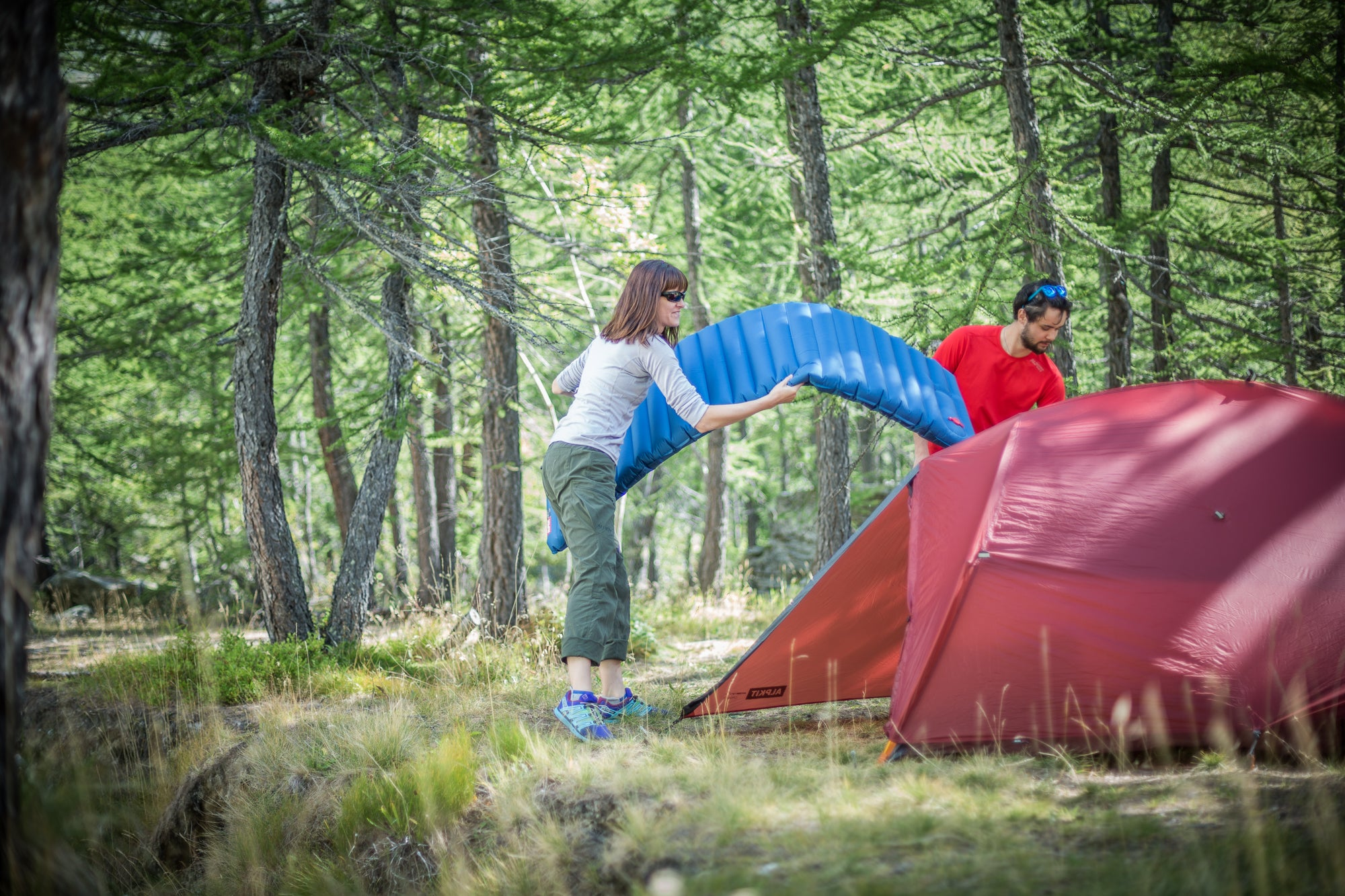 Trying to get a Dumo inflatable sleeping mat inside a tent in the woods near Chamonix