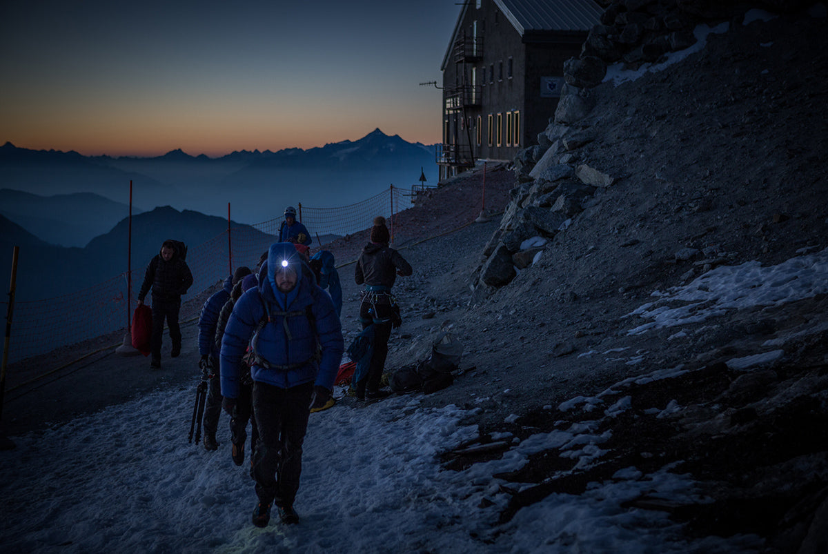Walking past an alpine hut at twilight in Slovenia