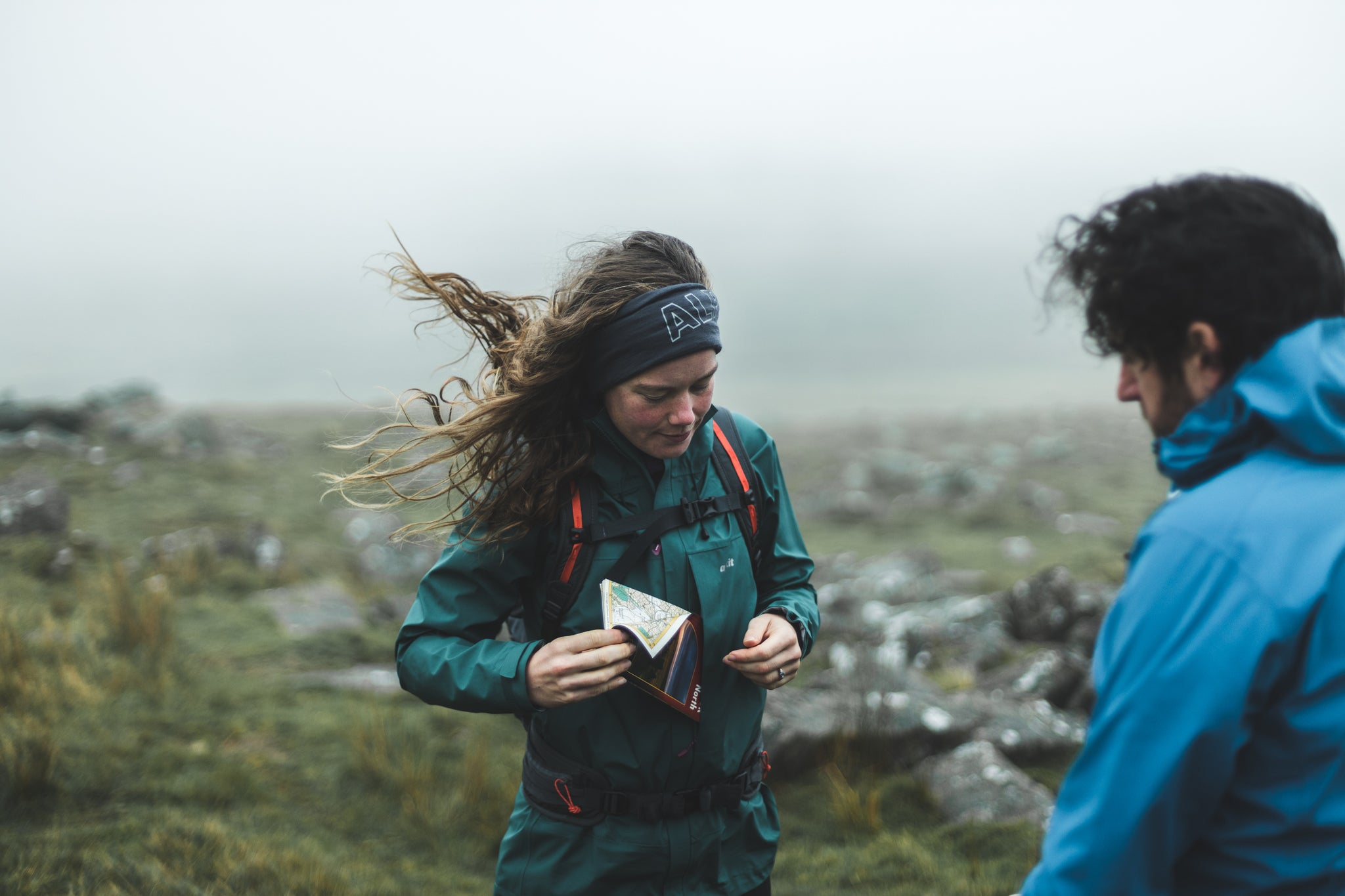 Putting a map in the pocket of the Fortitude hillwalking waterproof in Devon