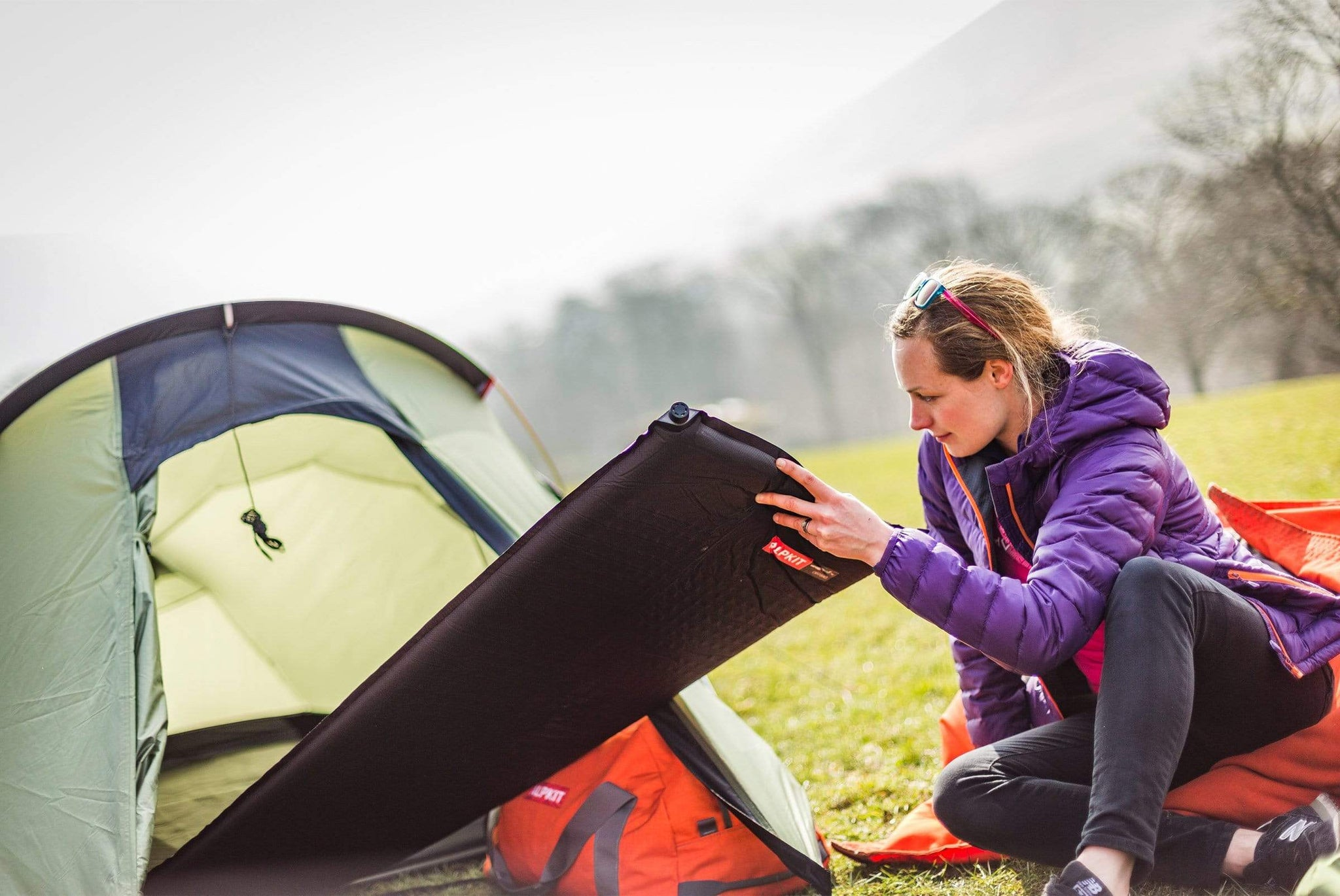Pushing a Dirtbag self-inflating sleeping mat into the tent in the Peak District