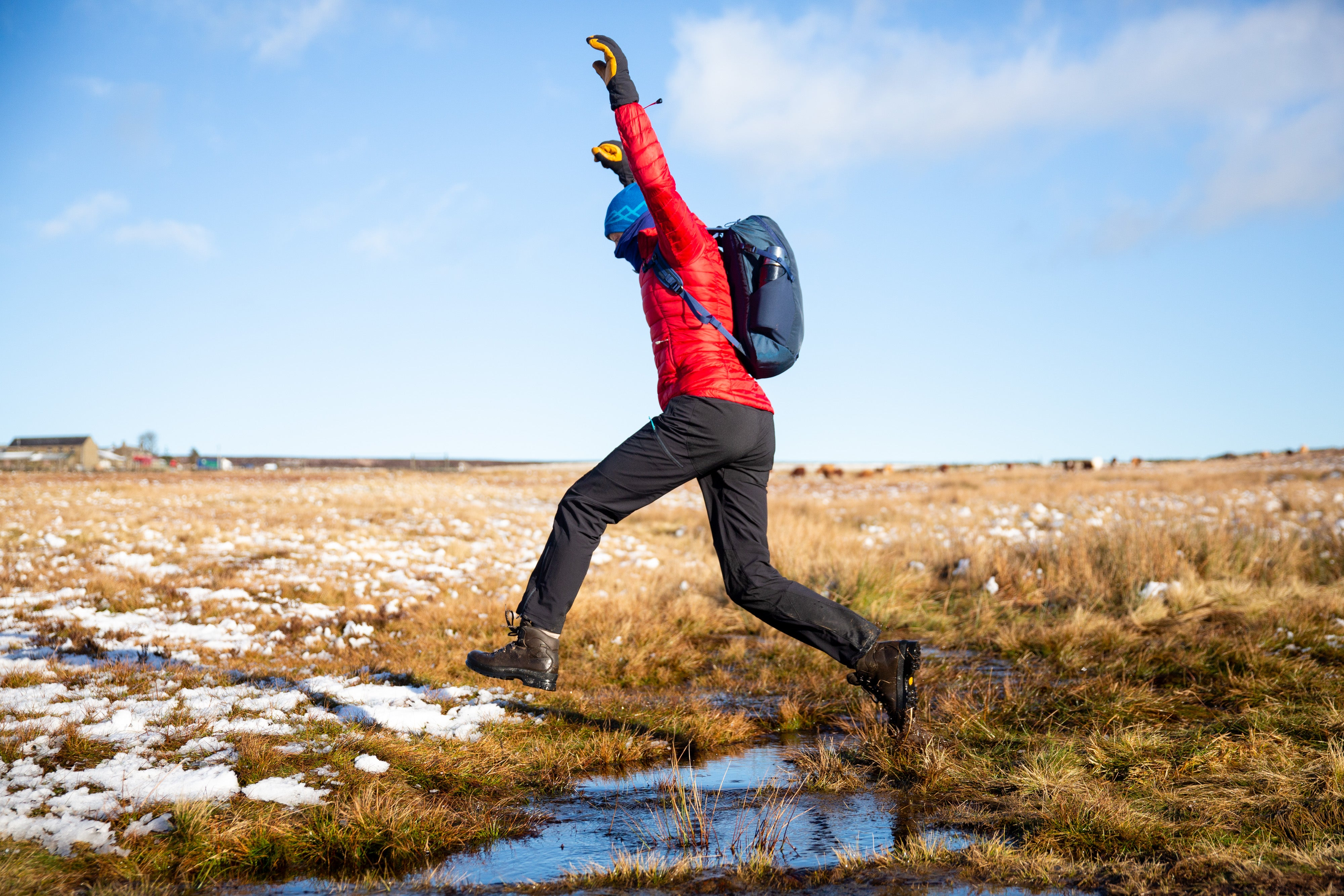 jumping over a bog in the Peak District with the Gnarl 15 rucksack