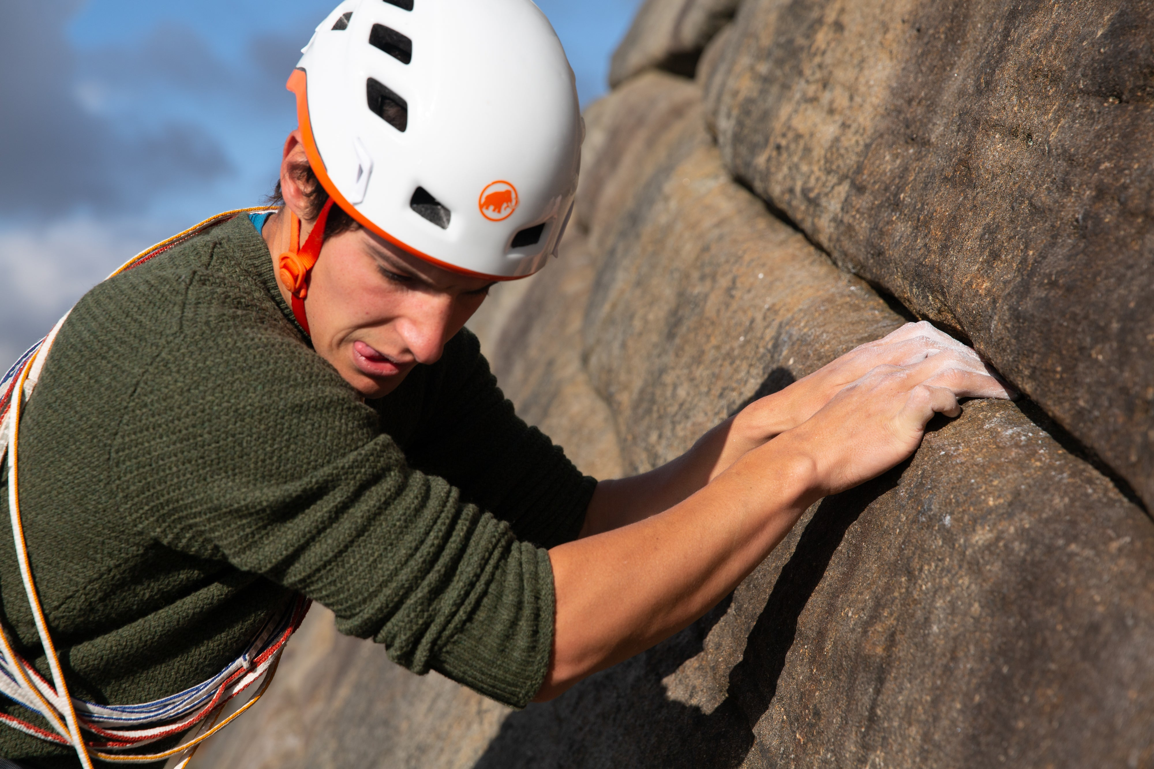 A man trad climbing on Stanage Edge in the Peak District