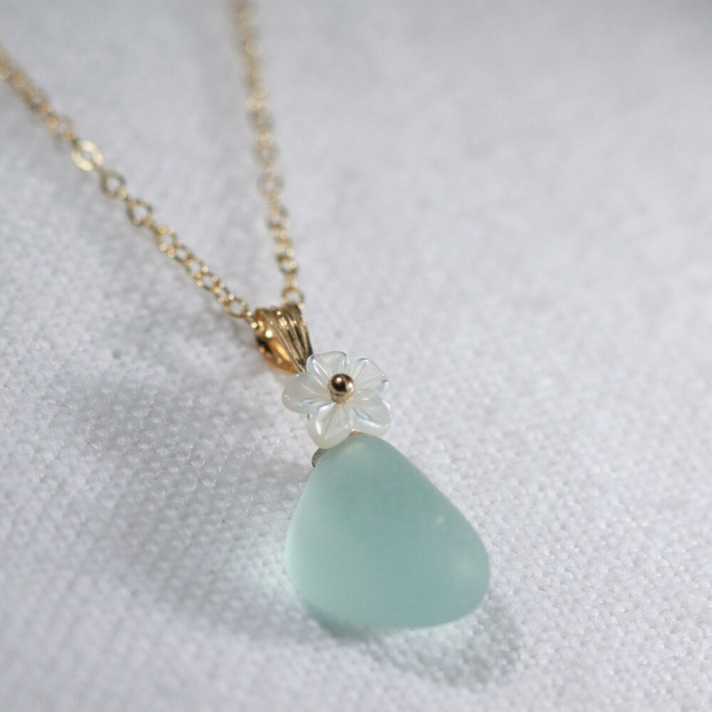 Aqua blue Sea Glass necklace in 14kt GF with a carved MOP flower