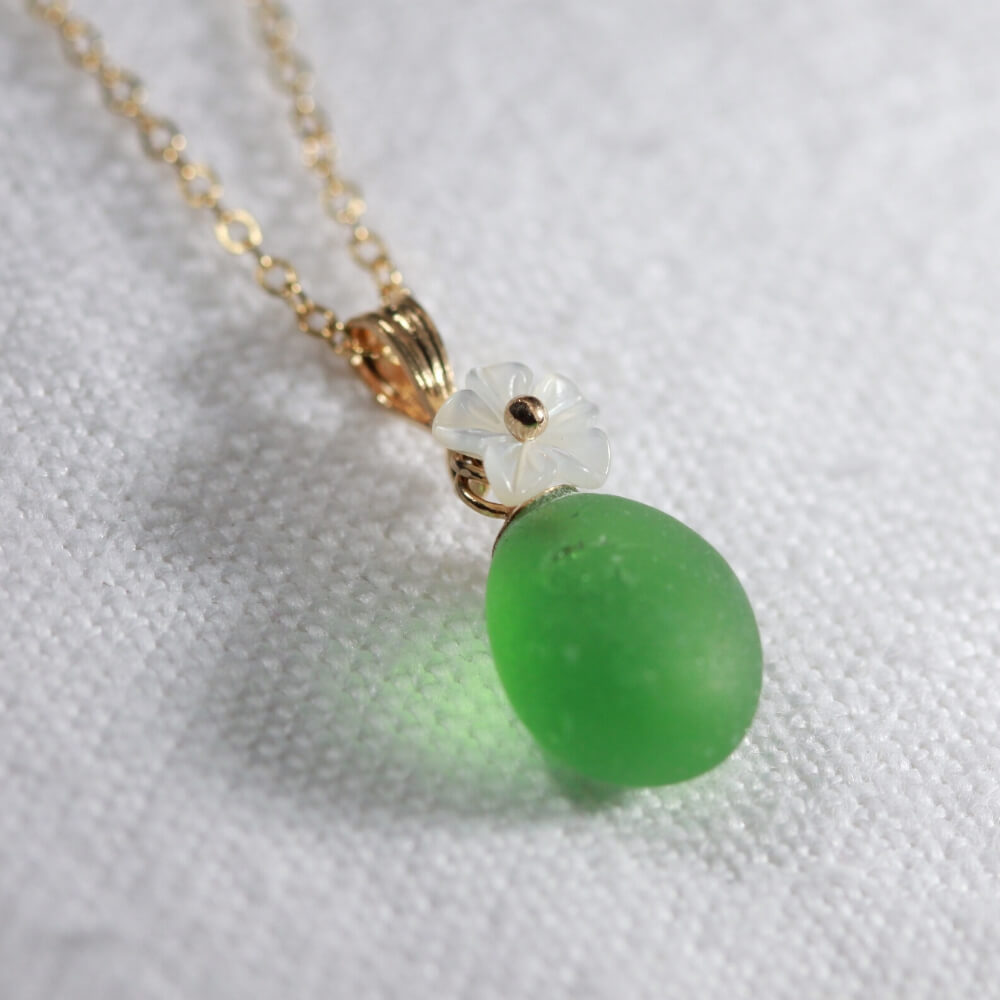 Bright Green Sea Glass necklace in 14kt GF with a carved MOP flower