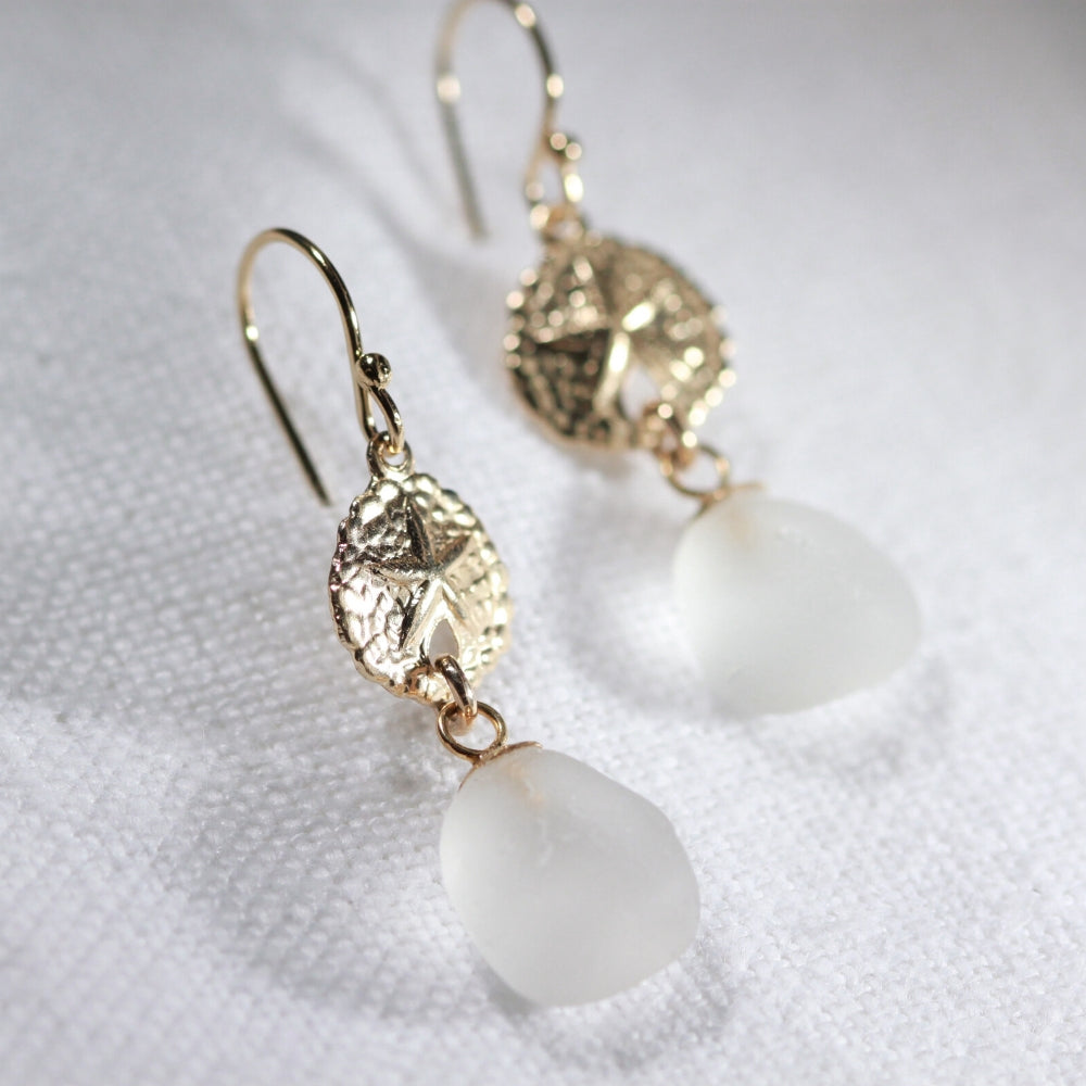 White Sea Glass Earrings in 14 kt gold-filled hanging from sand dollar charm