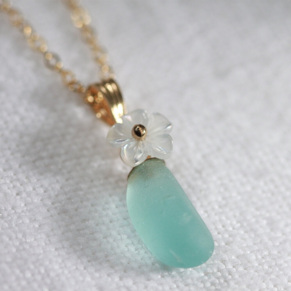 Copy of Aqua blue Sea Glass necklace in 14kt GF with a sweet carved MOP flower
