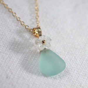 Pretty aqua Sea Glass necklace in 14kt GF with a sweet carved MOP flower