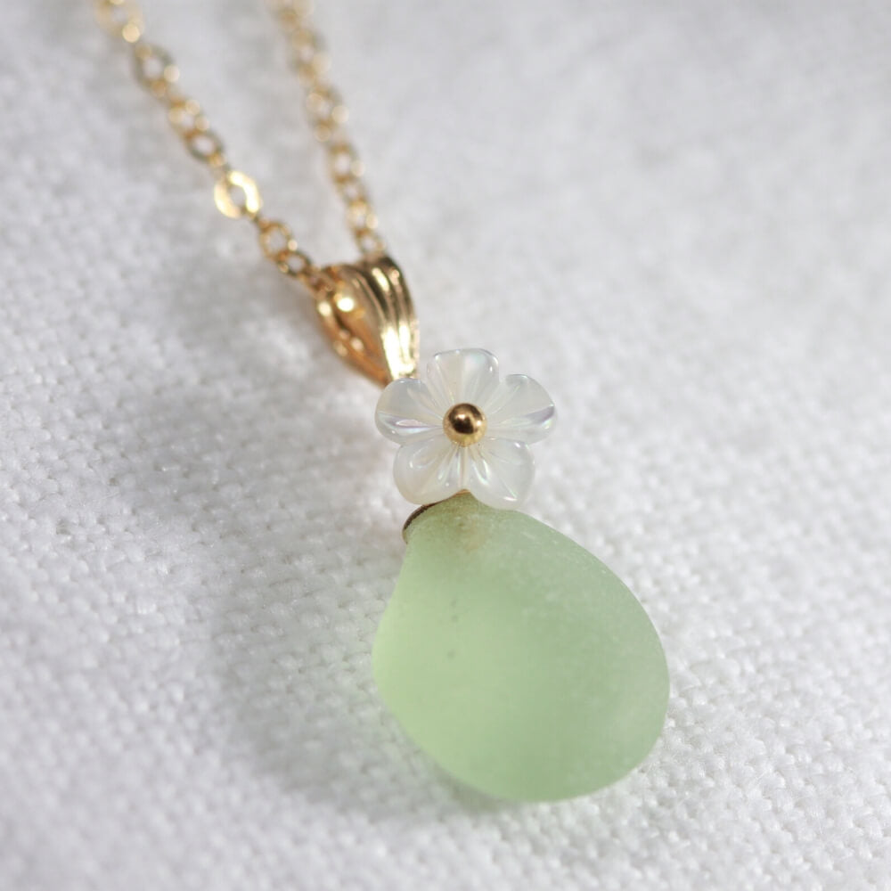 Sweet ocean green Sea Glass necklace in 14kt GF with a sweet carved MOP flower