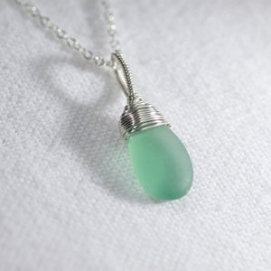 Ocean blue aqua Sea Glass necklace hand wire wrapped in Sterling Silver