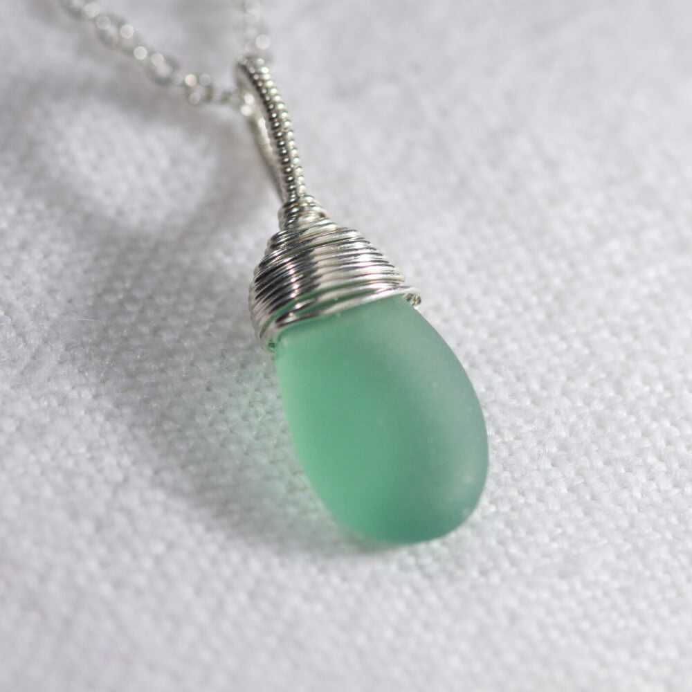 Aqua Sea Glass necklace hand wire wrapped in Sterling Silver