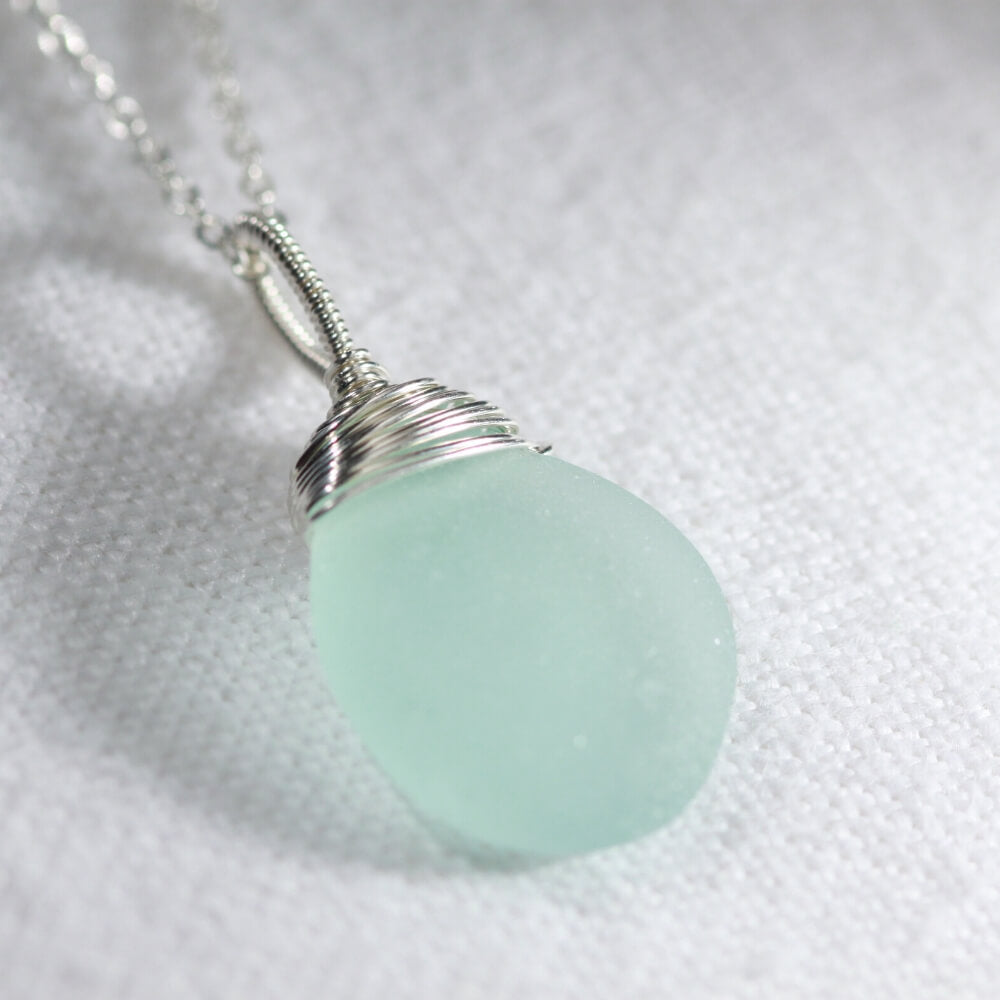 Aqua ocean blue Sea Glass necklace hand wire wrapped in Sterling Silver