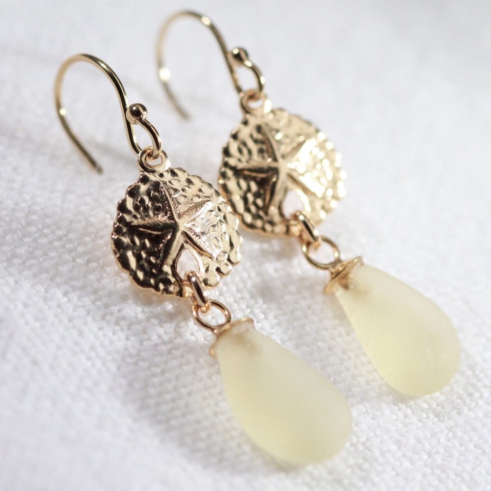 Yellow Sea Glass Earrings in 14 kt gold-filled hanging from sand dollar charm