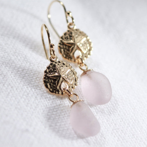 Lavender Sea Glass Earrings in 14 kt gold-filled hanging from sand dollar charm