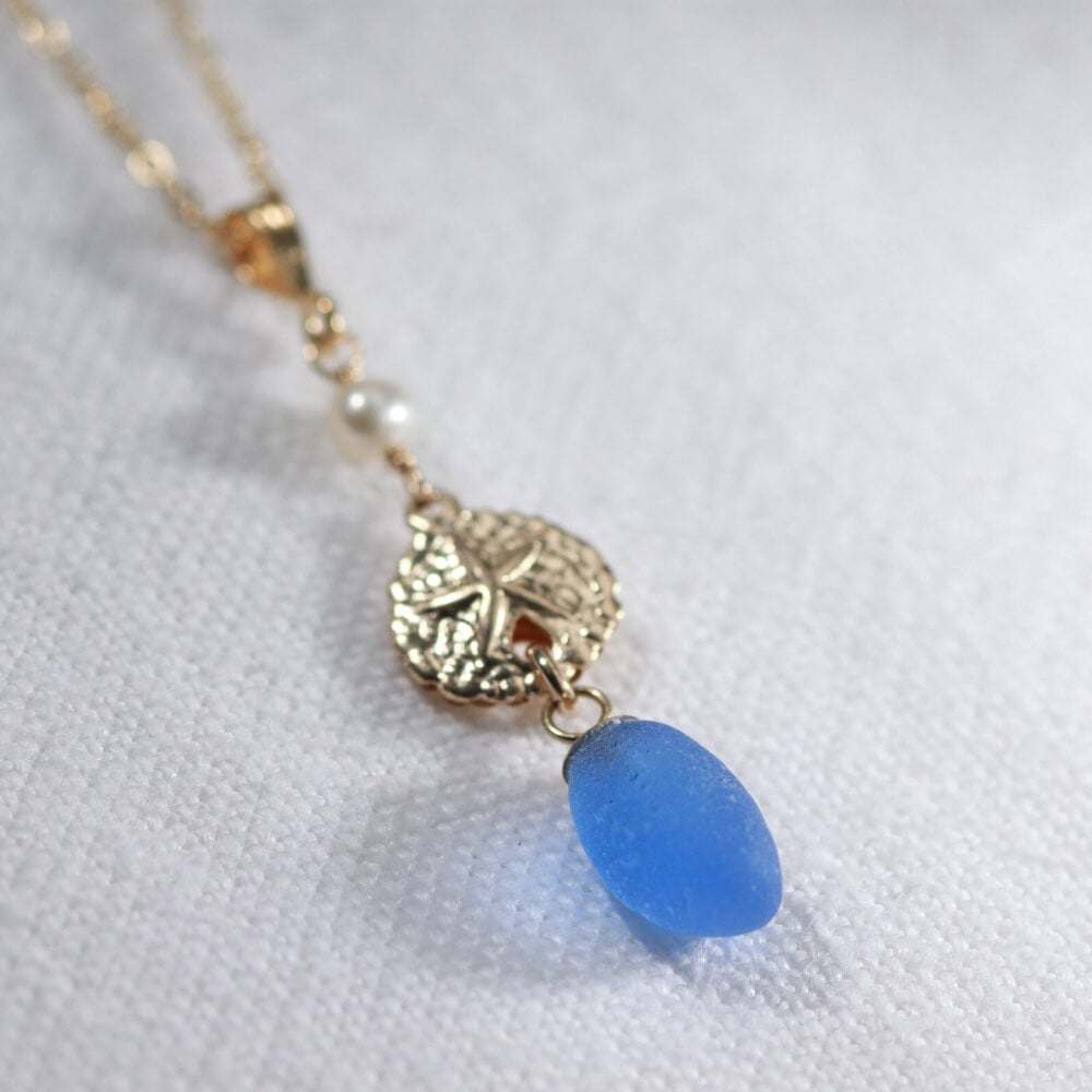 Cobalt Sea Glass necklace with a pearl and 14kt GF sand dollar