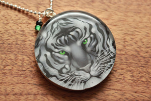 Green eyed Tiger necklace made from recycled Starbucks gift cards, sterling silver and resin