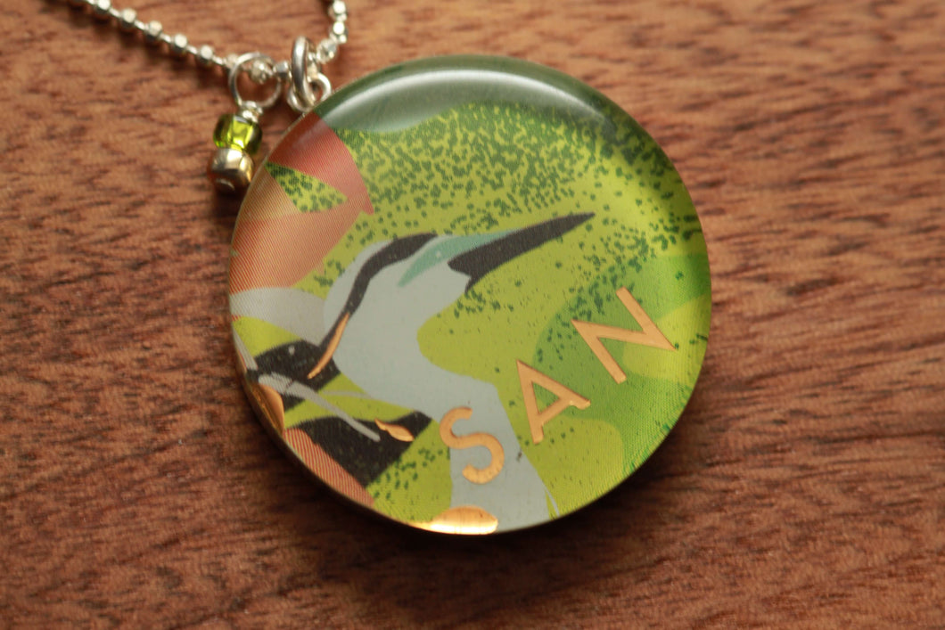 Great Blue Heron necklace made from recycled Starbucks gift cards, sterling silver and resin