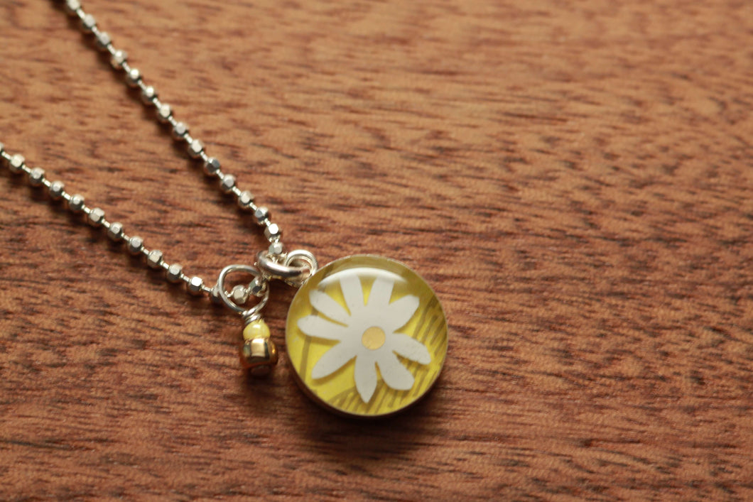 Daisy 12mm necklace made from recycled Starbucks gift cards, sterling silver and resin