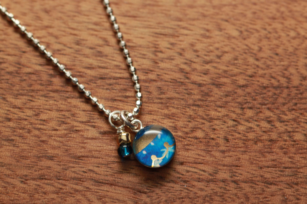 Tiny Ornament necklace made from recycled Starbucks gift cards, sterling silver and resin