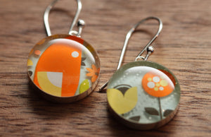 Bird and flower earrings made from recycled Starbucks gift cards. sterling silver and resin